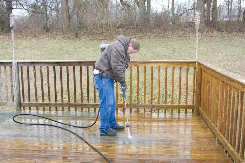 worker doing deck cleaning